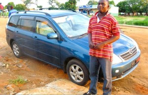 HENRY BANDA WITH HIS TOYOTA FIELDER